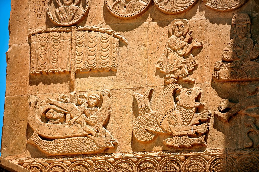 Bas Releif sculptures with scenes from the Bible, far left Jonah id swallowed by a whale, on the outside of the 10th century Armenian Orthodox Cathedral of the Holy Cross on Akdamar Island, Lake Van Turkey 42 : Stock Photo