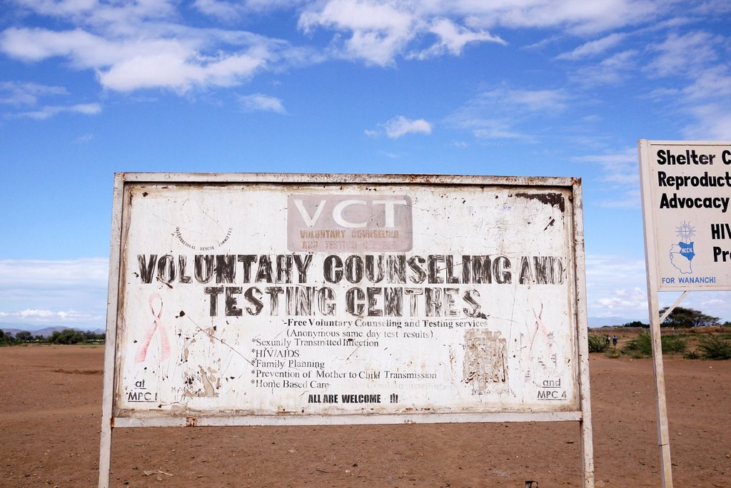Stock Photo: 1566-1223926 KENYA  Signs for various NGOs on the road outside the refugee camp at Kakuma, Turkana   photo by Sean Sprague