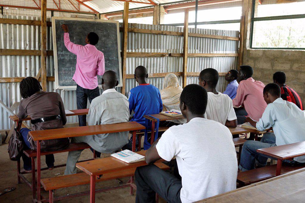 Stock Photo: 1566-1223933 KENYA  At Don Bosco´s school for vocational training, Kakuma refugee camp, Turkana  Students at an English class   photo by Sean Sprague