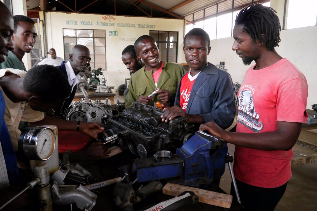 Stock Photo: 1566-1223935 KENYA  At Don Bosco´s school for vocational training, Kakuma refugee camp, Turkana  Motor mechanics class   photo by Sean Sprague