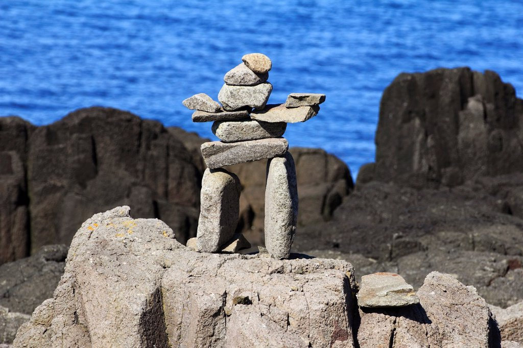 Stock Photo: 1566-1226029 An inuksuk plural inuksuit from the Inuktitut: , plural , alternatively inukshuk in English or inukhuk in Inuinnaqtun is a stone landmark or cairn built by humans, used by the Inuit, Inupiat, Kalaallit, Yupik, and other peoples of the Arctic region of North America  These structures are found from Alaska to Greenland  This region, above the Arctic Circle, is dominated by the tundra biome and has areas with few natural landmarks     The inuksuk may have been used for navigation, as a point of ref