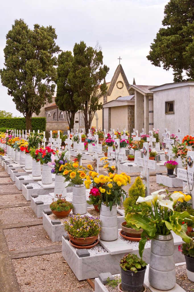 Crosses and flower arrangements at the Santa Maria della Neve church and memorial cemetery near Santa Agata, Italy : Stock Photo