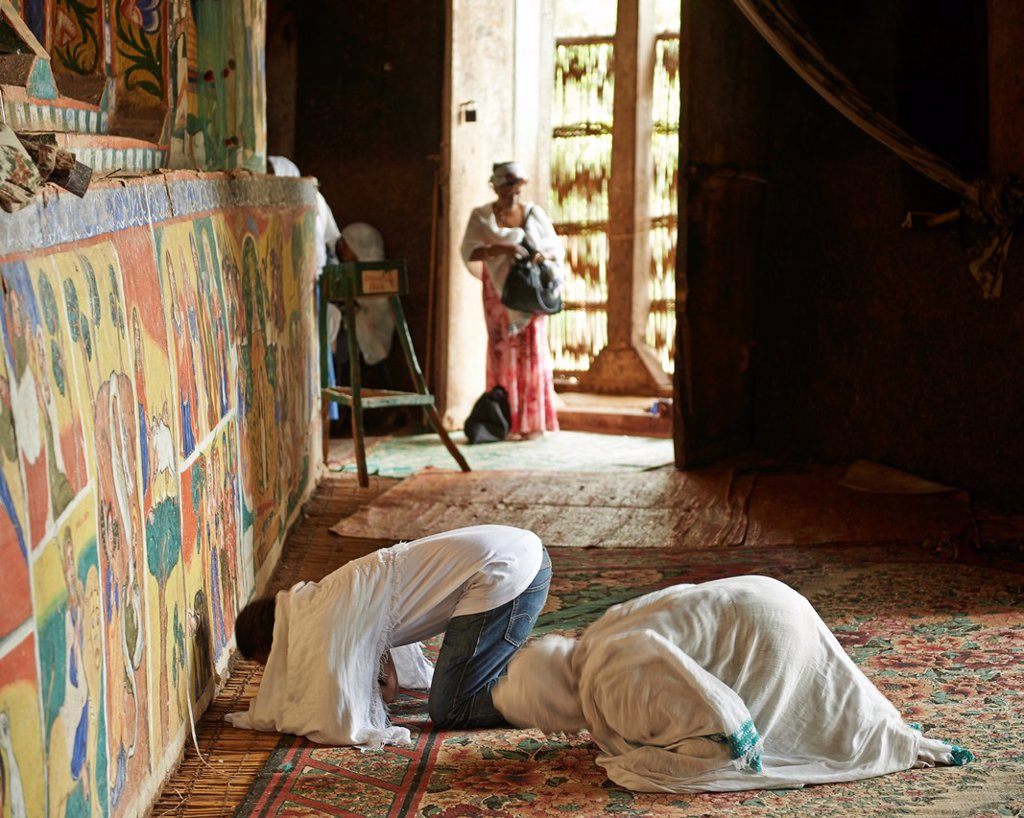 Stock Photo: 1566-1229803 Worshippers praying at The Ura Kidane Mihret, an Ethiopian Orthodox Church located on the Zege Peninsula in Lake Tana, Ethiopia