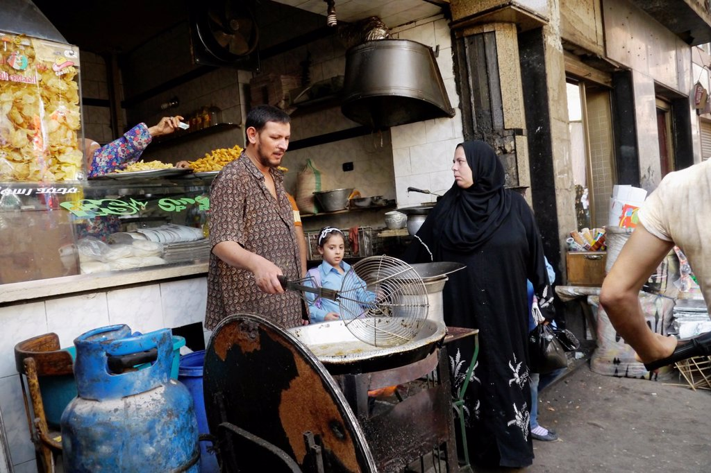 EGYPT  Street scenes in so called ´Islamic Cairo´, the old quarter of the city near Bab Zuela  Man frying felafels : Stock Photo