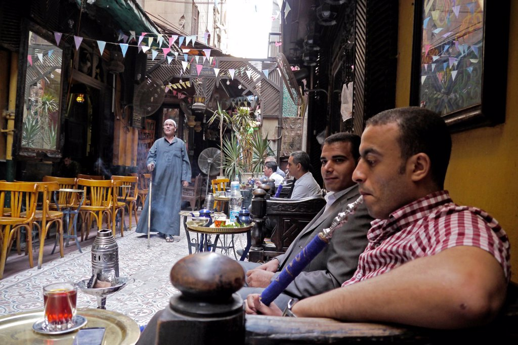 Stock Photo: 1566-1231278 EGYPT  Street scenes in so called ´Islamic Cairo´, the old quarter of the city near Bab Zuela  Man smoking shisha pipe