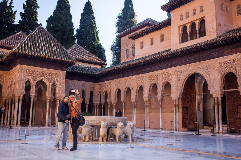 Stock Photo: 1566-1235953 Tourists in Courtyard of the lions  Palace of the Lions  Nazaries palaces Alhambra, Granada  Andalusia, Spain