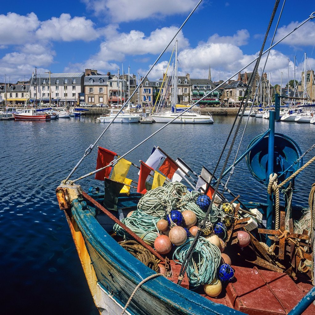 Fishing boat moored in Paimpol harbour Brittany France : Stock Photo