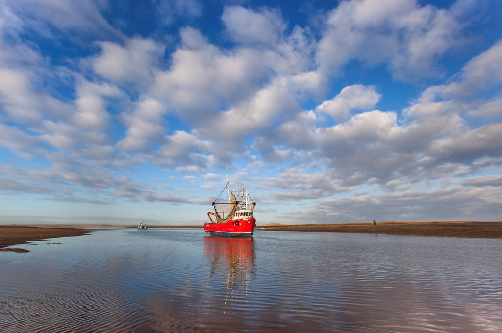 Fishing Boat Brancaster harbour mouth North Norfolk UK Winter : Stock Photo