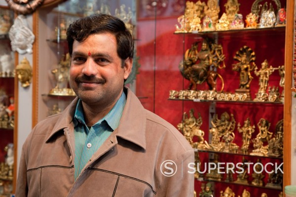 Stock Photo: 1566-1243717 India, Rishikesh  Vendor of Religious Statuettes and Figurines  Note the bindi on his forehead