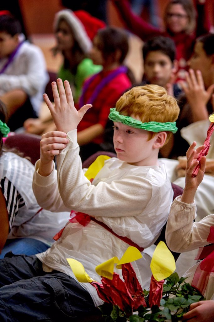 Stock Photo: 1566-1245686 A deaf child applauds in sign language during a Christmas pageant at the California School for the Deaf in Riverside, CA