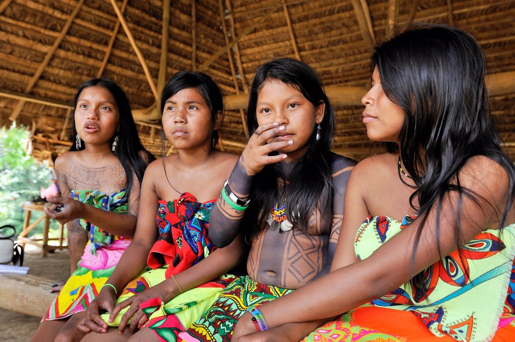 Stock Photo: 1566-1247513 Esilda on left and her friends, young teenagers of Embera native community living by the Chagres River within the Chagres National Park, Republic of Panama, Central America