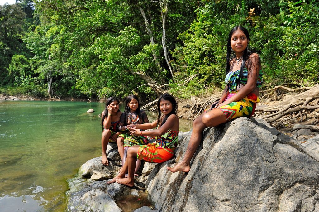 Esilda and her friends by the river, young teenagers of Embera native community living by the Chagres River within the Chagres National Park, Republic of Panama, Central America : Stock Photo