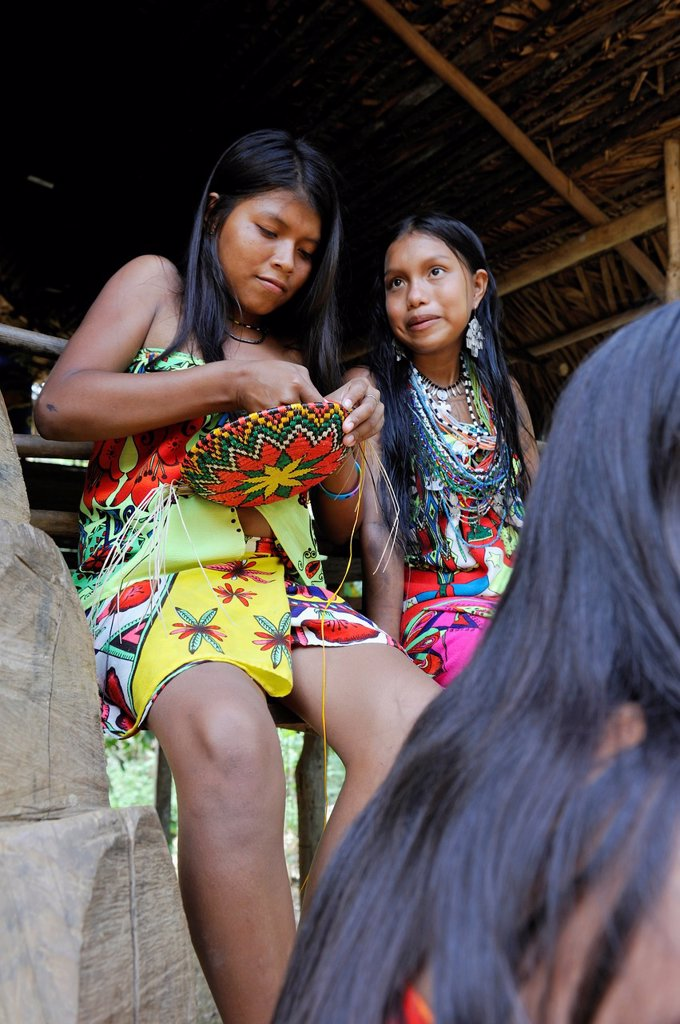 Stock Photo: 1566-1247532 Esilda and her friends making basket, young teenagers of Embera native community living by the Chagres River within the Chagres National Park, Republic of Panama, Central America