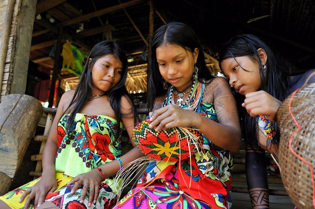 Esilda and her friends making basket, young teenagers of Embera native community living by the Chagres River within the Chagres National Park, Republic of Panama, Central America : Stock Photo