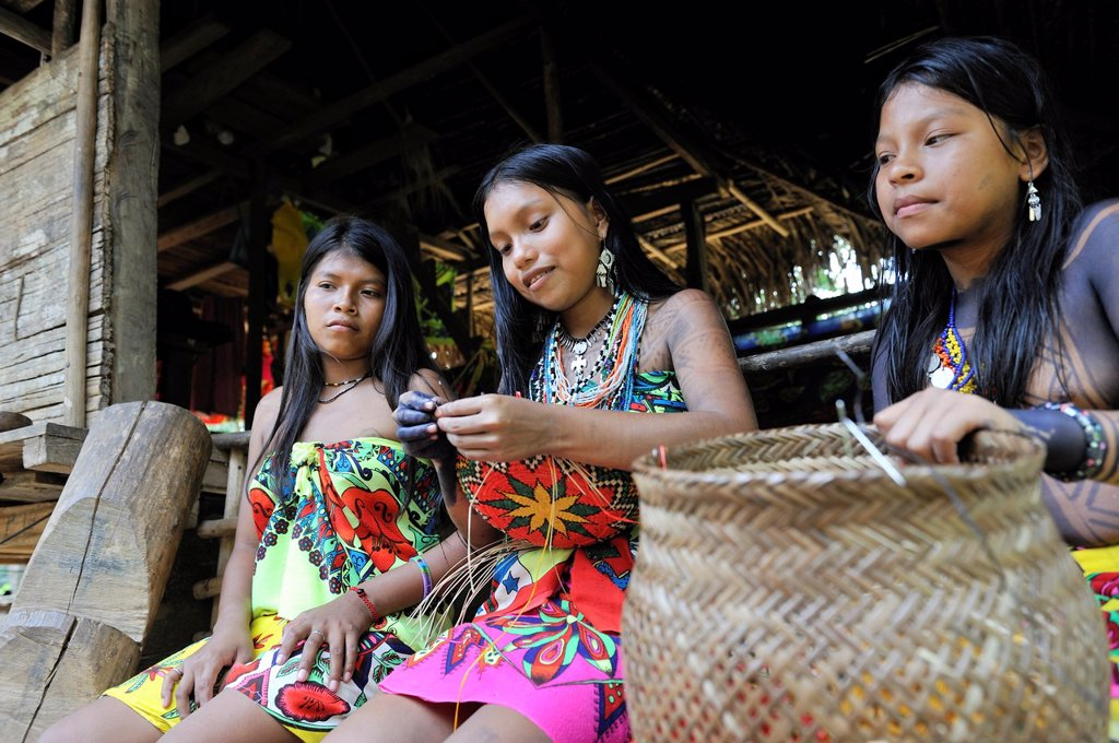 Stock Photo: 1566-1247538 Esilda and her friends making basket, young teenagers of Embera native community living by the Chagres River within the Chagres National Park, Republic of Panama, Central America