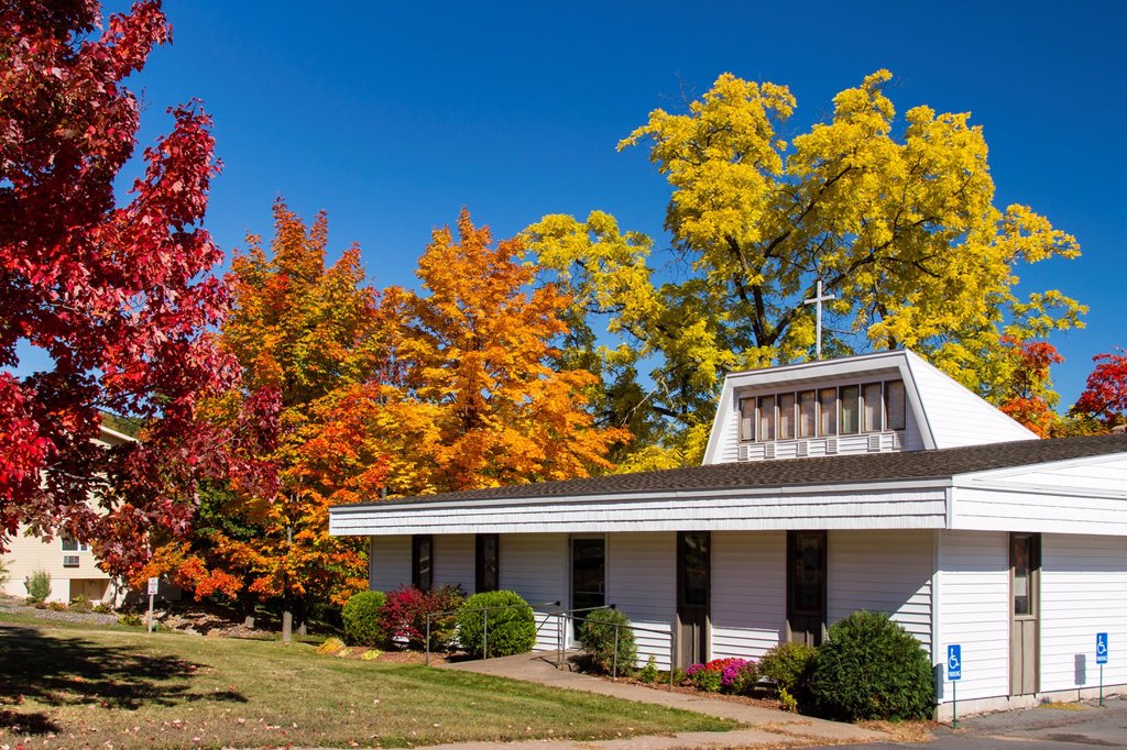 Stock Photo: 1566-1248489 The Faith Baptist Church with fall foliage color in Bayfield, Wisconsin, USA