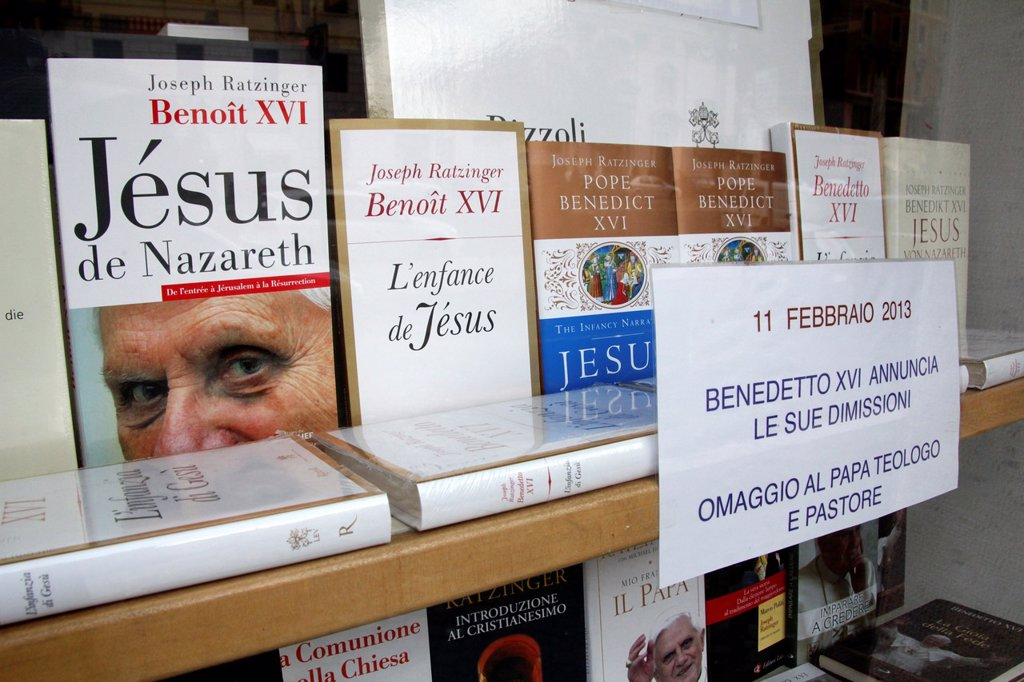 Stock Photo: 1566-1253462 11 Feb 2013 Bookshop window by the Vatican City, Rome following the resignation announcement by Pope Benedict XVI