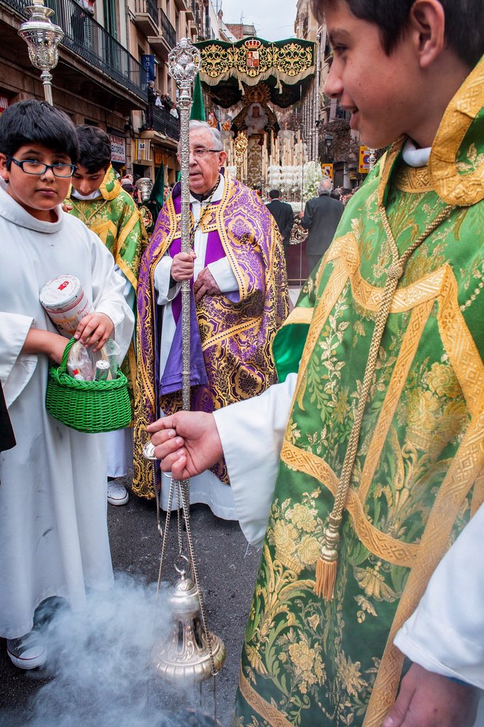 priest and altar servers in procession, sisterhood of Jesus del Gran Poder y virgen de la Macarena, Good Friday, Easter week, carrer Hospital, Barcelona, Catalonia, Spain : Stock Photo