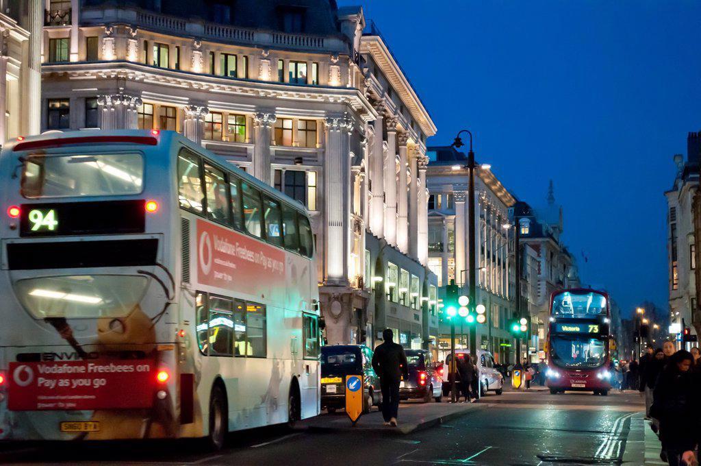 Stock Photo: 1566-1259231 Traffic at Oxford Circus at night, London UK