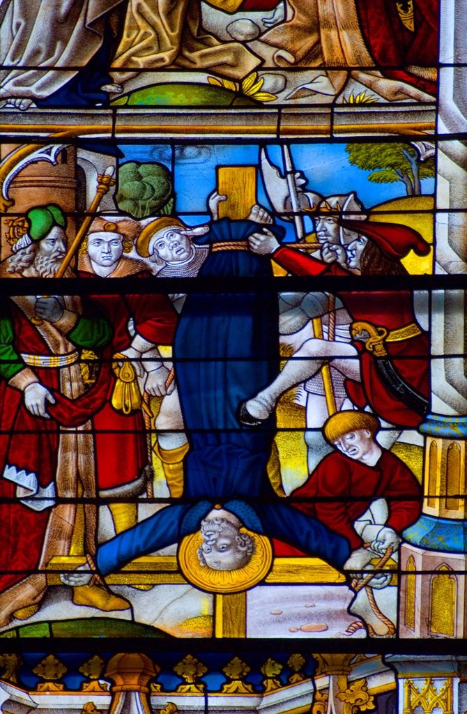 Stock Photo: 1566-1269252 Cologne (Koln), North Rhein Westphalia, Germany. Cologne Cathedral (Dom) Stained Glass Window. St Peter being Crucified upside-down