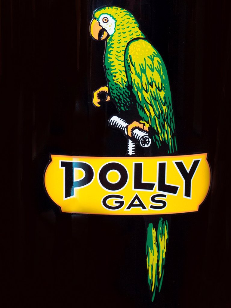 An amusing logo of a parrot decorates a 1935 service station gasoline pump. : Stock Photo