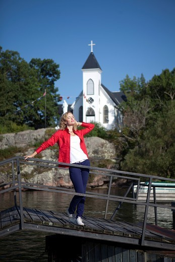 Woman in front of Church in Thousand Islands in Gananoque, Canada : Stock Photo