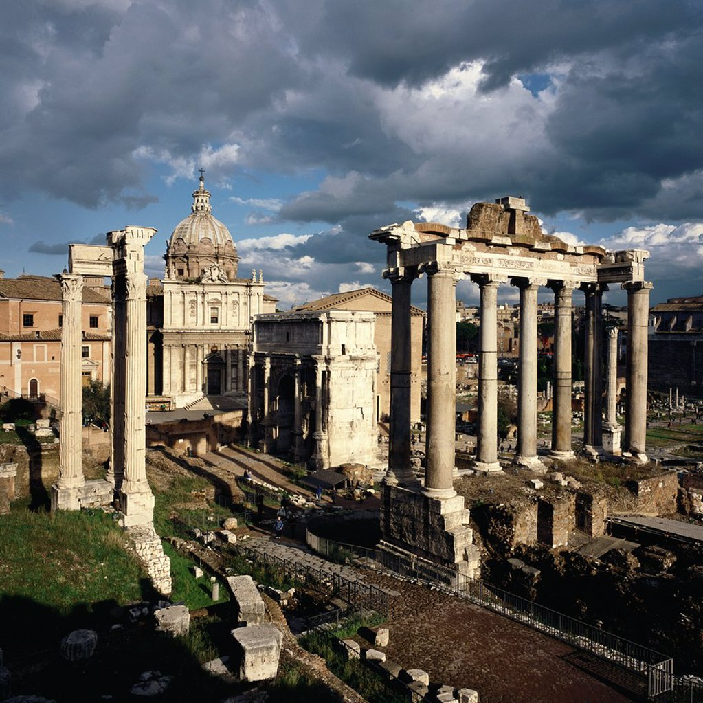 Stock Photo: 1566-1285870 Rome. Italy. The Roman Forum (Foro Romano). Foreground L-R, the Temple of Vespasian, the Church of Santi Luca e Martina, Arch of Septimius Severus and the Temple of Saturn.