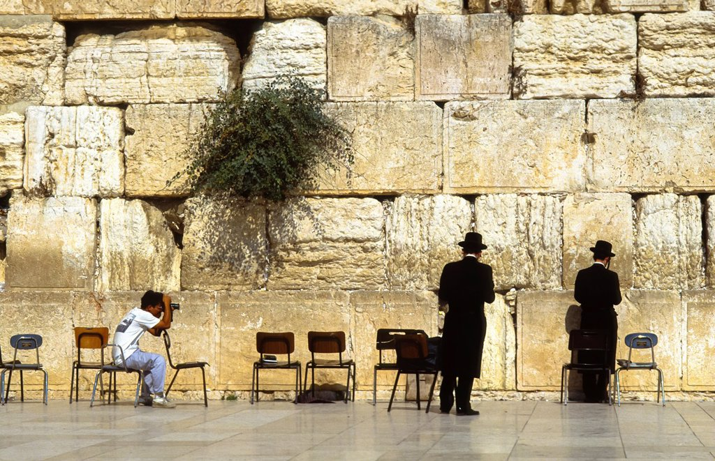 Stock Photo: 1566-1287751 Two praying jews at the Wall at Jerusalem being photographed