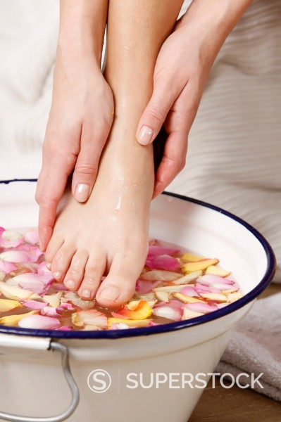 woman washing her feet : Stock Photo