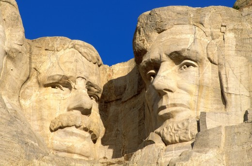 Morning light on Roosevelt and Lincoln faces on Mount Rushmore, Mount Rushmore National Memorial, South Dakota. : Stock Photo