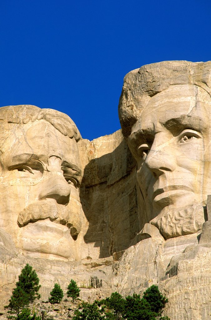 Stock Photo: 1566-1358617 Morning light on Roosevelt and Lincoln faces on Mount Rushmore, Mount Rushmore National Memorial, South Dakota.