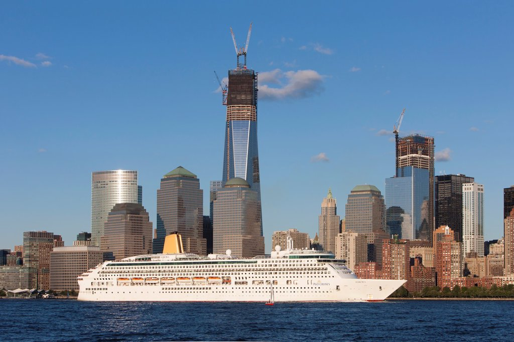 Stock Photo: 1566-1362971 PO Cruises cruise ship Aurora heads south on the Hudson River past the rising Freedom Tower and the lower Manhattan skyline.