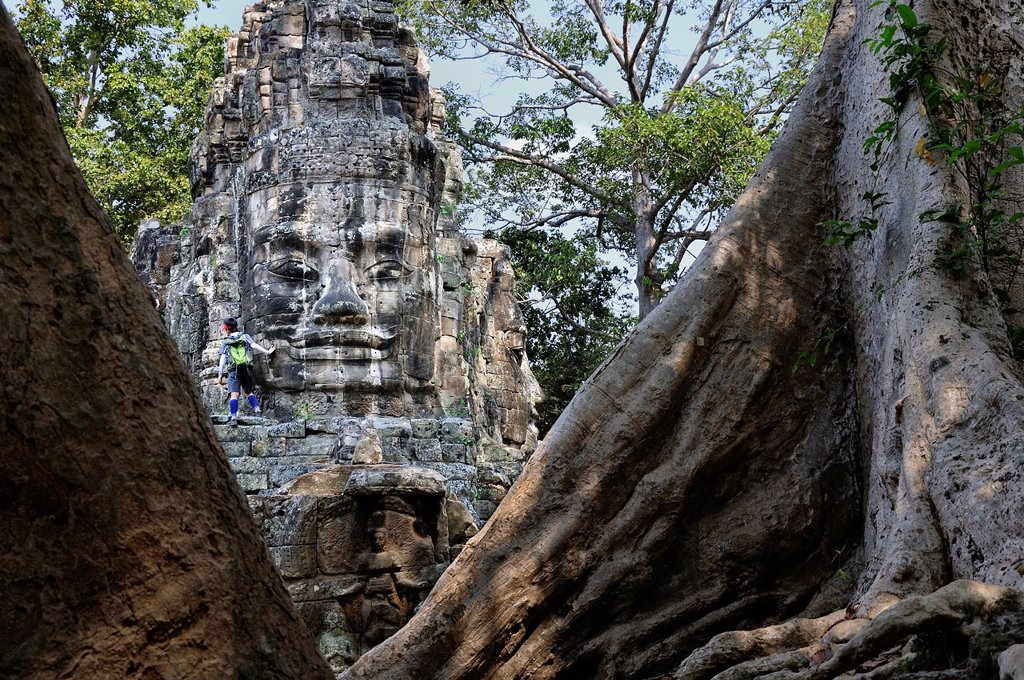 Stock Photo: 1566-1391286 Enigmatic Lokesvara stone faces on the east gate of Angkor Thom. Cambodia, Siem Reap, Angkor.