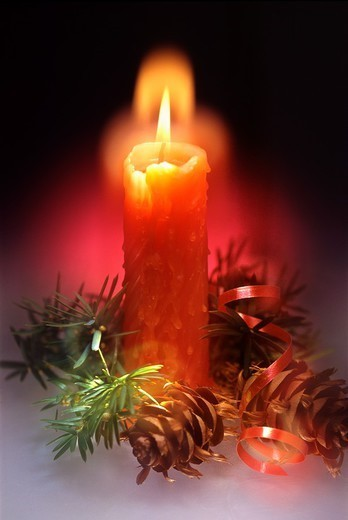 Stock Photo: 1566-1401512 Red burning Christmas candle  Christmas still life