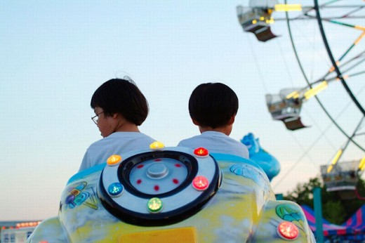 4 year old and 6 year old Chinese kids at Fair in Oswego, Illinois, USA : Stock Photo