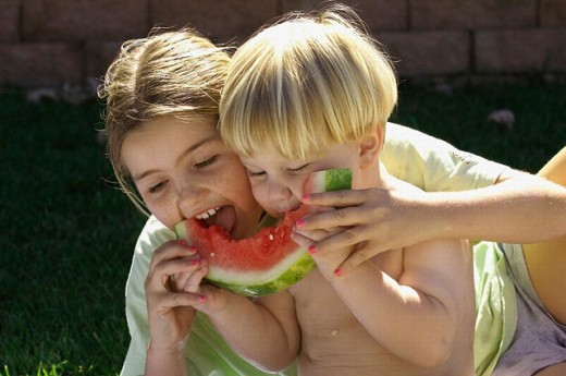 Kids eating watermelon together : Stock Photo