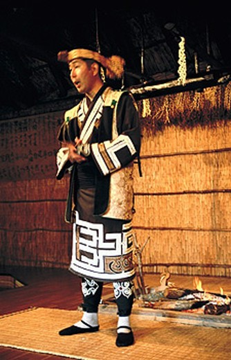 Man in traditional Ainu dress, Poroto Kotan. Hokkaido, Japan : Stock Photo