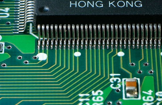 Electronic circuits from a computer´s hard disk controller. : Stock Photo