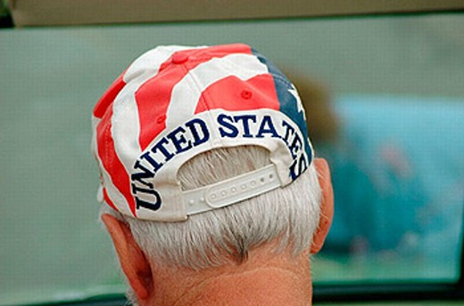 Stock Photo: 1566-251353 Senior man with flag of the USA on hat at event