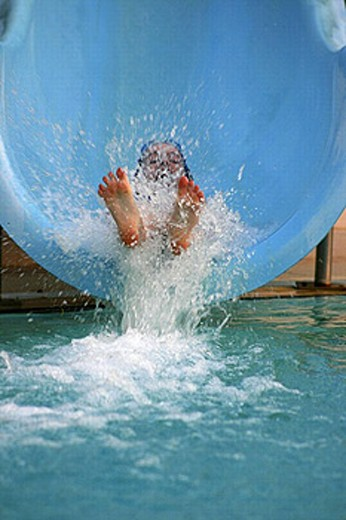 Feet of a girl splashing off a water slide into a pool, Abu Dhabi, United Arab Emirates. : Stock Photo