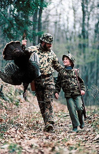 Stock Photo: 1566-252316 Turkey hunting, father and son