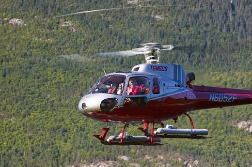 Temsco Helicopter taking tourists on Glacier Tours. Skagway. Southeast Alaska. USA. : Stock Photo