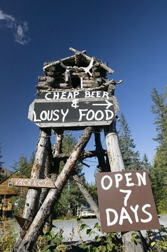 ´Cheap Beer & Lousy Food´ offered on Exit Glacier Road. Seward. Kenai Peninsula. Alaska. USA. : Stock Photo