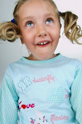 Simpering blond child. : Stock Photo