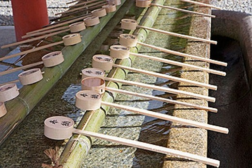 Stock Photo: 1566-256200 Bamboo water dippers at fountain, Fushimi Inari Taisha Shrine. Kyoto. Kansai, Japan