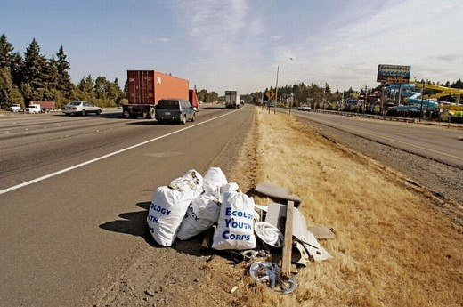 Trash pickup on Interstate highway of litter in Seattle WA by Ecolory Youth corps volunteers, in bags for disposal : Stock Photo