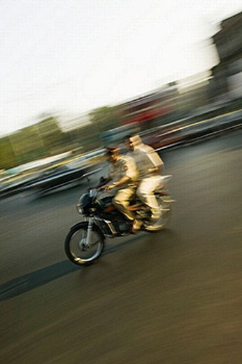 Speeding motorcycle traffic, Bombay. Maharashtra, India (2004) : Stock Photo