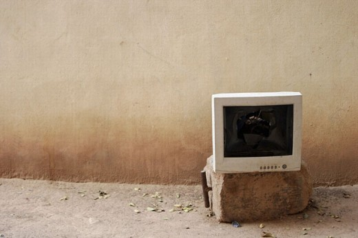 Broken computer screen, abandoned. : Stock Photo