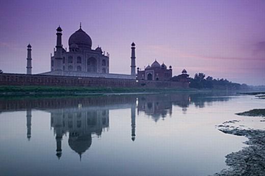 Stock Photo: 1566-260646 Taj Mahal. Seen from the East along the Yamuna River. Dusk. Uttar Pradesh. Agra. India.