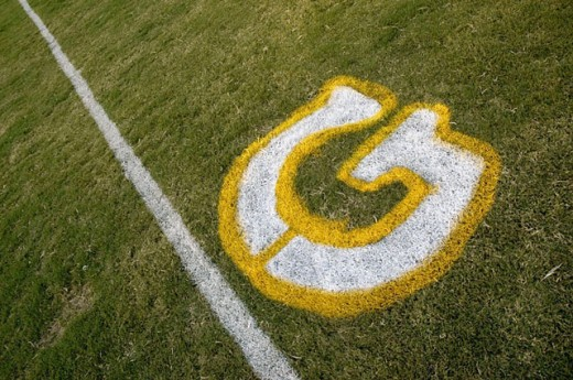 Painted yardage lines of football field, some being painted : Stock Photo
